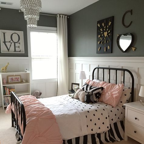 Little girls room. Pottery Barn, shanty 2 chic, hobby lobby, Homegoods and Target! Board and batten walls set the room off with dark gray walls by sherwin Williams and a black iron bed.