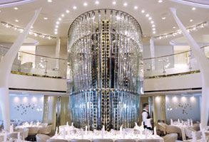 "@CelebrityCruises Solstice - in the main dining room. The magnificent chandelier is right behind the Captain's Table and right in front of the enormous wine ""cabinet."""