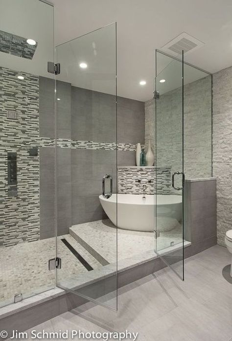 TOP BATHROOM TRENDS    We love a classic bathroom that stays on trend for years to come. To keep it feeling modern use a monochromatic element throughout the space. You can still stay neutral and make it something really special.    #bathroomdecorideas  #trends2020 #stylishprojects #decorideas #bathroominspiration