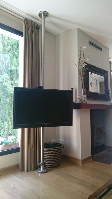 Tv giratoria con una tubería | Wall mounted tv, Ceiling tv ...