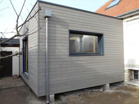 Agrandissement de maison réalisé en ossature bois avec toit plat et
