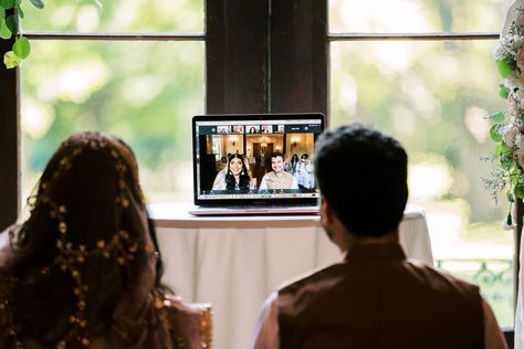 Ameera and Rafi visiting with their guests virtually as they celebrate at their small family wedding at Riverwood Mansion. #riverwoodmansion #intimatewedding #covidweddingideas