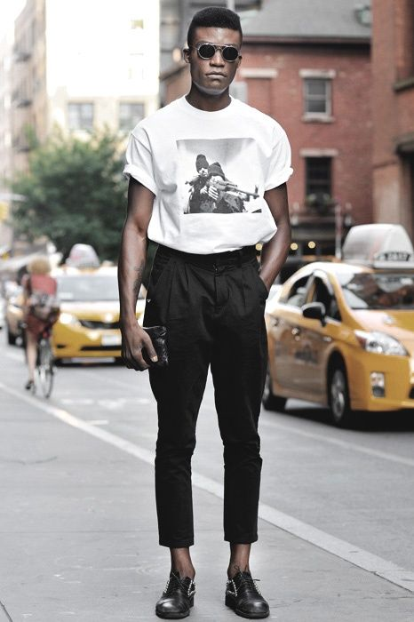 Shop this look for $247:  http://lookastic.com/men/looks/white-and-black-crew-neck-t-shirt-and-black-chinos-and-black-zip-pouch-and-black-oxford-shoes/2431  — White and Black Print Crew-neck T-shirt  — Black Chinos  — Black Leather Zip Pouch  — Black Embellished Leather Oxford Shoes