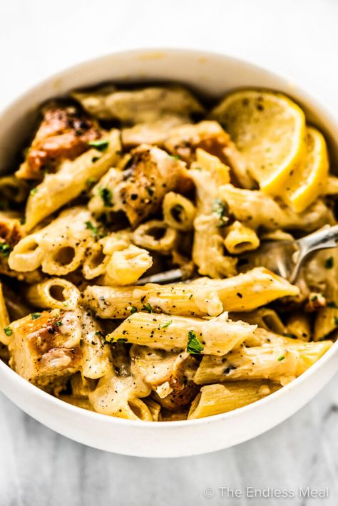 PIN TO SAVE! This lemon chicken pasta is creamy, flavorful, and has just the right bright/tart lemon taste. It's an easy, 35-minute dinner recipe you don't want to miss! #theendlessmeal #pasta #lemonpasta #lemonchickenpasta #chicken #lemon #lemonchicken #chickenpasta #easymeals #healthymeals #pastadinner #pastarecipes #chickenrecipes #glutenfree #sugarfree