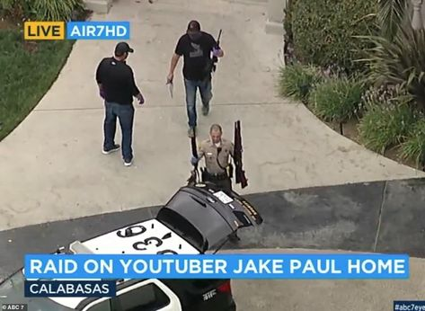 Law enforcement officers were seen walking out of Jake Paul's Calabasas mansion on Wednesd...