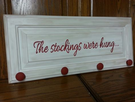 The stockings were hung.....made with cabinet door