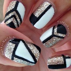 Glittery gold/white and black nail design.