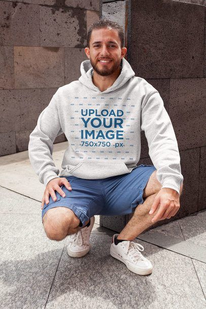 Download Placeit Heathered Pullover Hoodie Mockup Featuring A Smiling Man In A Crouching Position Hoodie Mockup White Hoodie Hoodies