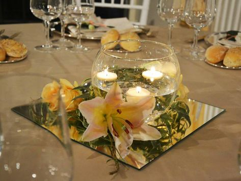 candele galleggianti gigli e rose salmone