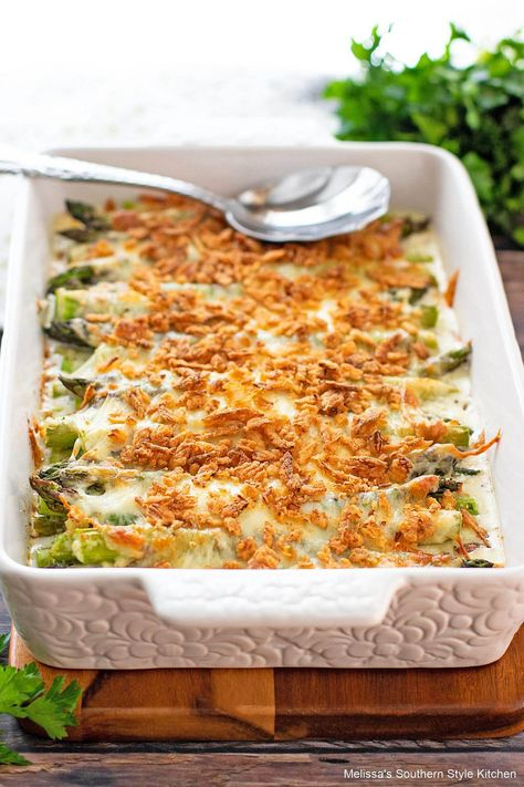 This oven roasted Cheesy Baked Asparagus is a decadent side dish that will elevate your side dish options #cheesybakedasparagus #asapragusrecipes #roastedasparagus #freshasparagusrecipes #southernrecipes
