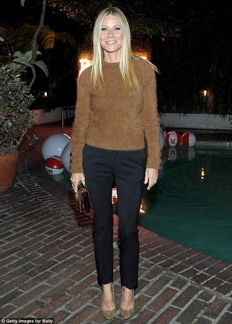 21 April 2016, Thursday, LA. Gwyneth Paltrow wore a fuzzy burnt orange sweater with black silky trousers, adding a colorful handbag and tan heels. She opted for a simple pair of pointed neutral hued heels and delicate rings to finish off her stylish ensemble for the event.