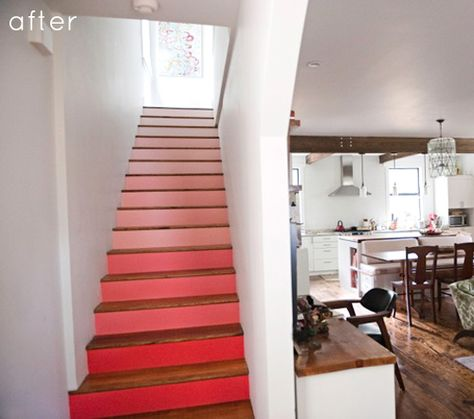 When you think of transforming your floors, don't overlook the stairs! A pink ombre treatment turns a simple set of stairs into a bright, beautiful point of drama in this lovely home.
