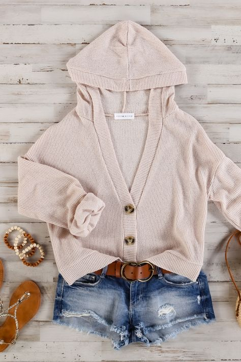 This adorable cardigan is ideal for strolling through gorgeous April showers. A light, waffle-style knit and long sleeves make it light yet cozy, and a button opening and a roomy hood add some practicality. 83% Polyester, 17% Rayon Hand wash cold, do not bleach, do not wring, line dry, do not iron Measures 20.5 from shoulder to hem on size small Model wearing a size small Imported #summerstyle #summercardigan #fashioninspooutfits #summervibes #summeraesthetic #cardigansforwomen