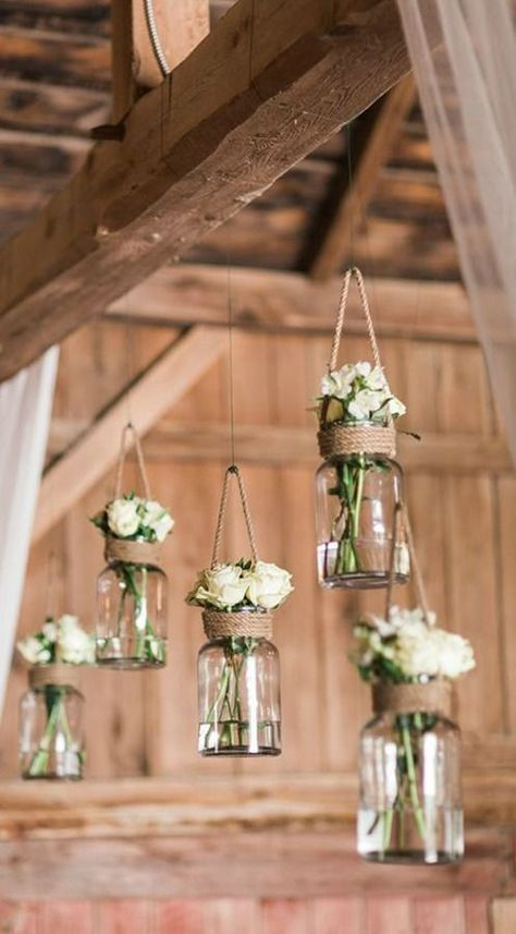 LOVE these hanging mason jar flower vases for rustic, vintage or barn wedding decor The post This Couple Restored a Barn So They Could Get Married In It appeared first on Best Pins for Yours - Wedding Gown Burlap Wedding Decorations, Wedding Table Numbers, Table Decorations, Decor Wedding, Table Wedding, Barn Wedding Centerpieces, Wedding Lighting, Rustic Lighting, Wedding Preparation