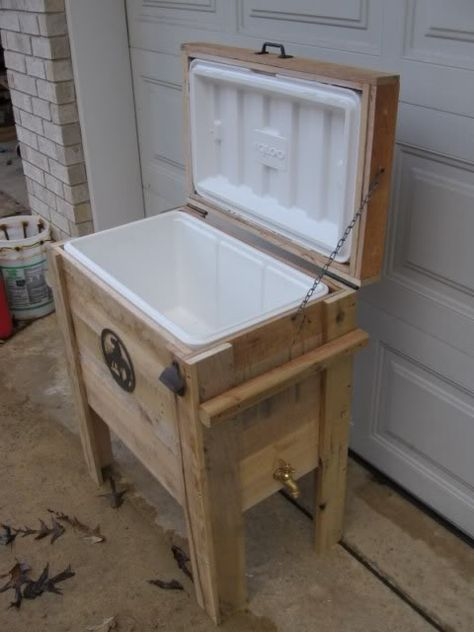Cooler holder made out of pallet lumber. The spigot ties in to the drain on the cooler.