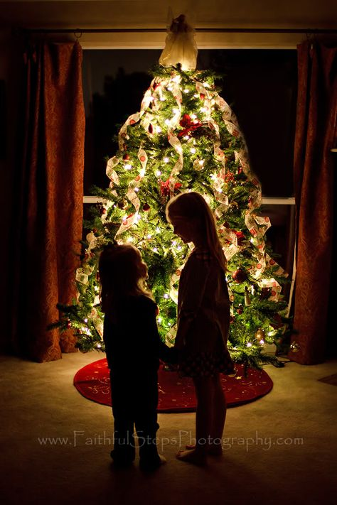 Photographing Kids in Front of a Christmas Tree from Faithful Steps Photography.  Dark room (all the lights off in the house except for Christmas tree lights), f-stop 1.4, ISO 160, SS 1/15.  Make sure kids stand still. Love this!! (@Jillian Smith)