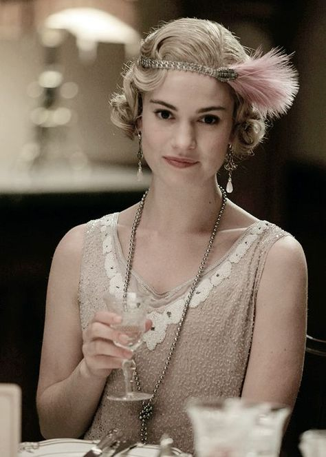 Lily James as Lady Rose MacClare. A perfect expression of grace and classic fashion. Lily James as Lady Rose MacClare. A perfect expression of grace and classic fashion.