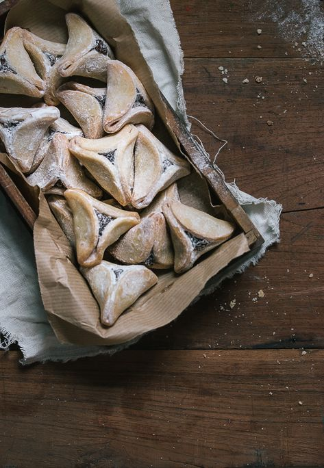 hamantaschen cookies with poppy seeds, nuts & raisin filling