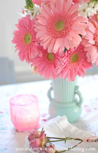 When you need to cheer a room in your house, arrange a cheerful bouquet of pink gerbera daisies. They're sure to lift your spirits on the dreariest of days!