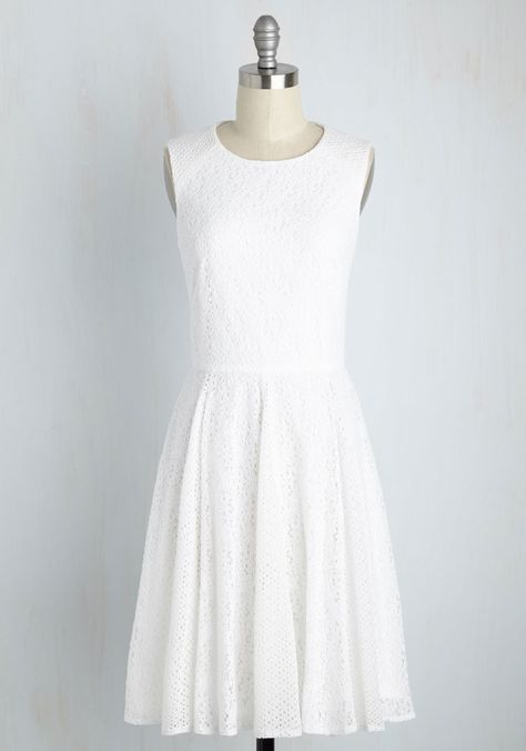 With your amour holding one hand and a glass lifted in the other, you call the reception to a toast in this white dress.