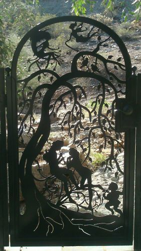 This is a gorgeous gate to embellish that perfect spot. An exquisite design with extensive detail. A fellow plays a flute for his love. A child listens nearby holding flowers. Elf-girls sit on the moon's crest and fly in the trees.