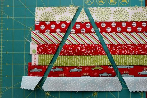 """Scrappy Christmas Table Runner Size: x Block size: Materials 1 ½"""" strips assorted prints (I used a honeybun of Holly's Tree Farm from Moda) Background fabric, neutral (I used Kona Snow), cut into 6 strips Cotton quilt batting, such as Warm […] Table Runner Tutorial, Christmas Runner, Christmas Table Runners, Quilted Table Runners, Quilted Table Runner Patterns, Quilted Table Toppers, Tree Quilt, Tablerunners, Mug Rugs"""