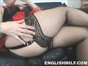 Sexy British wife in fishnet stockings and suspenders showing lots of thigh. English milf video stills.