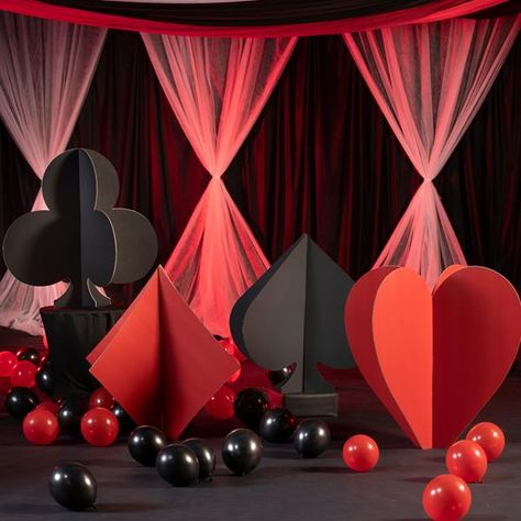 Don't gamble on fun decor, choose our Roll the Dice Slotted Card Suit Props for your next casino party. This set of cardboard props include a red heart and diamond, along with a black spade and club.