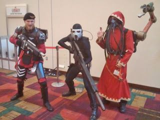 Warrior Acolyte, Vindicare Assassin, and a Tech-Priest.