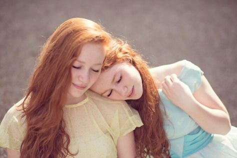 Beautiful redhead twin sisters