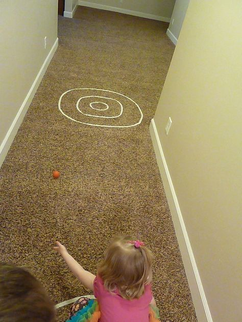 maskingtape indoor games -hopscotch, bulls-eye bowling, tic-tac-toe, guard the eggs, long jump, balance beam