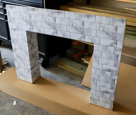 No fireplace? Check out how you can make your own renter-friendly DIY faux fireplace with peel and stick tiles available at The Home Depot! Faux Fireplace Insert, Faux Mantle, Faux Fireplace Mantels, Christmas Fireplace, Fireplace Inserts, Brick Fireplace, Fireplaces, Cardboard Fireplace, Rental Decorating