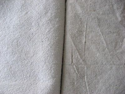 How to bleach drop cloths to lighten and soften them for reupholstery.