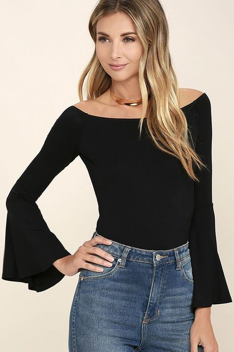 fd28fa345a An elasticized off-the-shoulder neckline tops a fitted jersey knit bodice,  and long bell sleeves. Choose the Flirt Factor Black ...