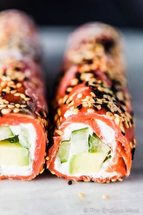 SAVE FOR LATER! Tzatziki Avocado Salmon Rolls are the perfect party appetizer. They're totally delicious, easy to make, super pretty, and healthy. Bonus: they can be made ahead of time! #theendlessmeal #salmon #tzatziki #appetizer #seafood #fish #smokedsalmon #glutenfree #keto #lowcarb #holidayappetizer #partyappetizer #healthyrecipes #cucumber #cucumberbites #salmonroll