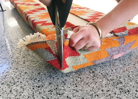 Make this quick and easy mid-century modern style bench using a cheery colored kilim rug!
