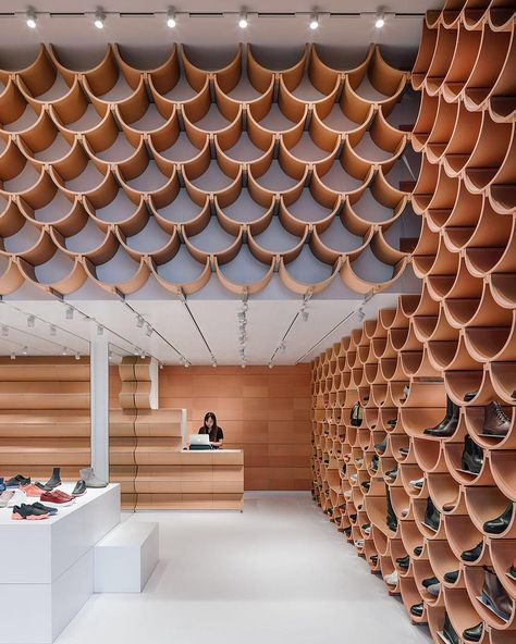 """designboom magazine on Instagram: """"#kengokuma has completed the renovation of a #retail space for @camper #shoes in #barcelona. facing the plaza catalonia, the scheme by…"""""""