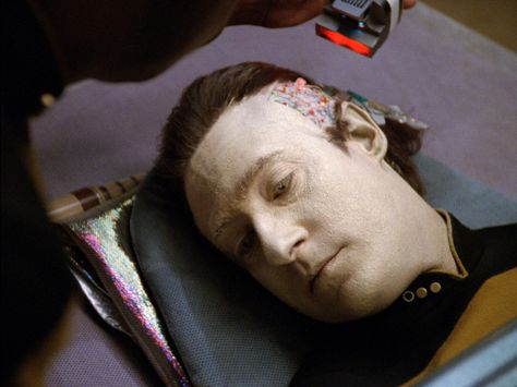 "Data's (Brent Spiner) positronic brain is examined in Star Trek: The Next Generation's ""Deja Q."""