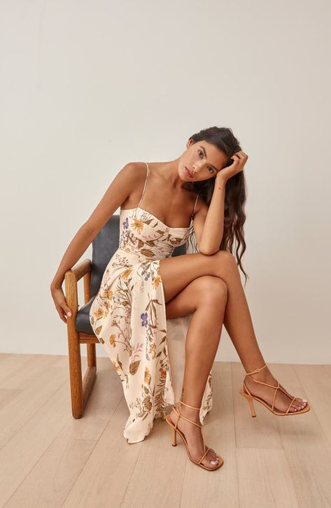 Seamed cups and side ruching shape the curve-hugging fit of this sultry sundress that's slit to the thigh for a leggy finish.