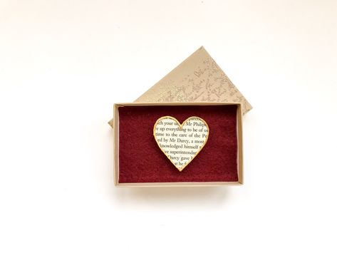 These magnets have been in the shop for a while now but they still look good I think, although they take a good while to make! The box is hand embossed with shimmering script. Mr Darcy Magnet, Heart Magnet Made from a Page from 'Pride and Prejudice' by Jane Austen, Edged with Gold and Boxed #mrdarcy #janeausten #prideandprejudice #bookish #magnets #literarygifts #bookishcrafts  #mrdarcymagnet #giftforbooklover  #etsy