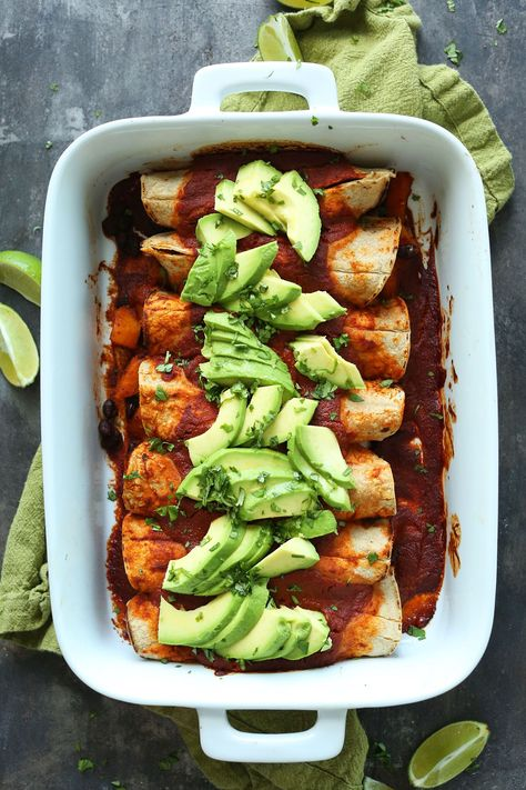 Simple butternut squash black bean enchiladas made from scratch with just 10 ingredients! A savory, satisfying plant-based meal even picky eaters will love.
