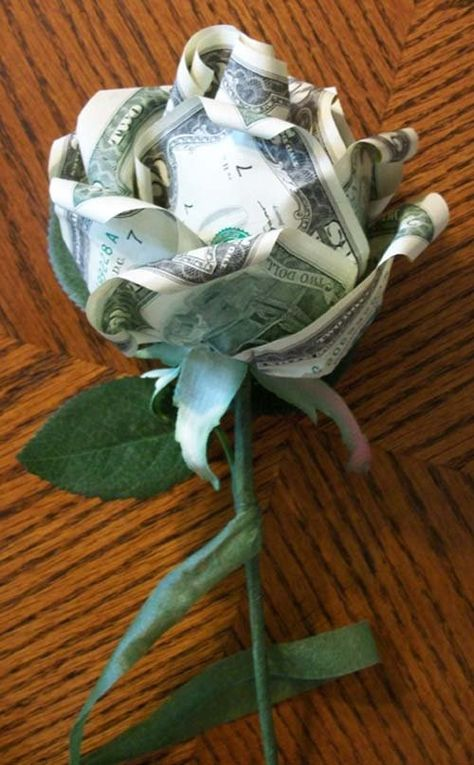 How to make a money rose...trust me, do it for a wedding.  You won't regret it and you will blow everyone's mind even if you can only afford a small arrangement.