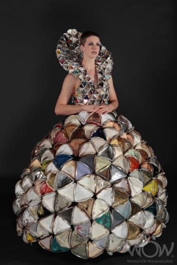 A garment made from old paint tin lids collected in the aftermath of the Christchurch earthquakes by third-year fashion design student Nicole Linnell, has won the Shell Student Innovation Award at the 2012 Brancott Estate World of WearableArt Show.
