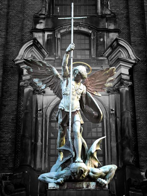 Sculpture of the archangel Michael defeating Satan, St Michael's Church, Hamburg, Germany Angels Among Us, Angels And Demons, Male Angels, Statue Ange, St. Michael, Michael Angel, Michael Wolf, Cemetery Art, Cemetery Statues