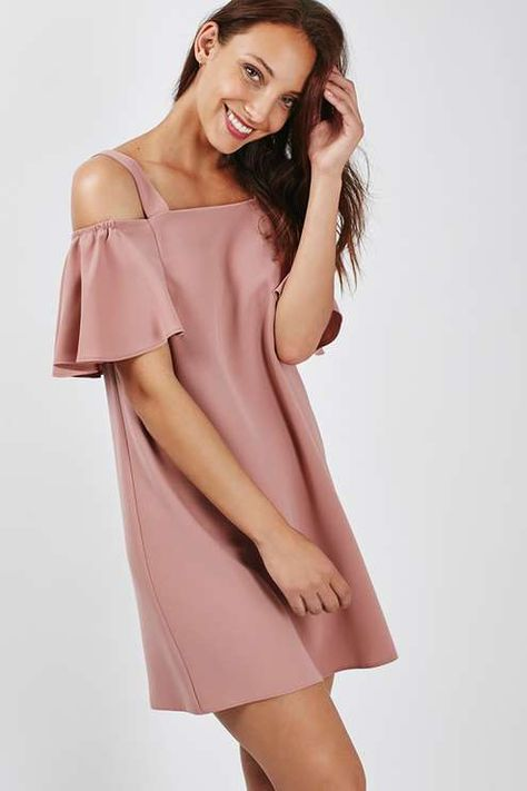 Bare shoulders remain a firm favourite for the new season. Dress yours up with clean details in this bardot dress - A relaxed silhouette makes it easy to wear, while a more structured shape and flared sleeves make it perfect for day-to-night styling. #Topshop
