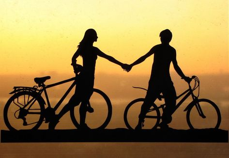 Holding Hands Couple with Bicycles Handmade Original Papercut First Anniversary Gift: Hand-Cut Paper Art Silhouette. $30.00, via Etsy.