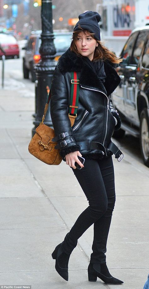 Dakota Johnson.. Acne Studios jacket, J. Brand jeans, Tabitha Simmons booties, Gucci bag, and Christian Dior earrings.. #NYC #ohdakota