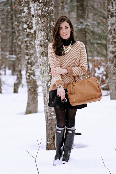 Sweater by Ganni, necklace by J.Crew, skirt by Topshop, boots by Hunter, bag by Tory Burch, tights by Anthropologie, socks by Blarney Woolen Mills. (January 26, 2014)