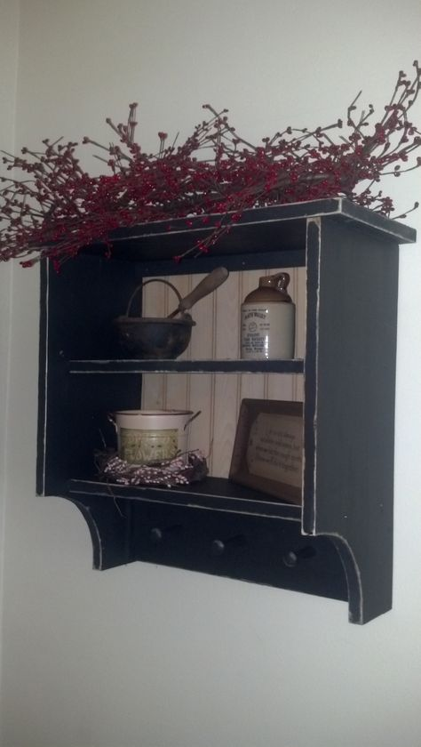 Primitive wall shelf with shaker pegs, perfect for all your country knickknacks!