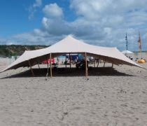 Stretch Tent on the beach provided by Igloo Structures unique tent hire - covering Cornwall & Unique tent hire covering Cornwall and Devon. Stretch tents ...
